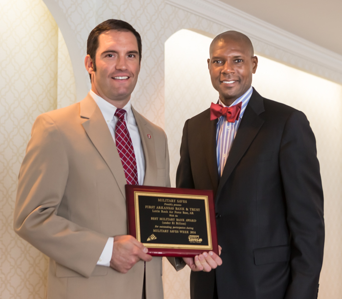 Mark Wilson accepts the Military Saves Award on behalf of First Arkansas Bank and Trust